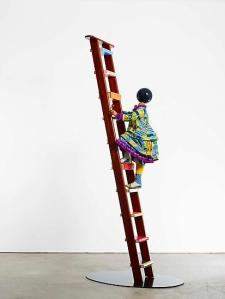 YINKA SHONIBARE, MBE Magic Ladder Kid I 2013 Mannequin, Dutch wax printed cotton textile, leather, fiberglass, wooden ladder, steel baseplate, globe Overall: 118 x 48 x 31 1/2 in. (300 x 122 x 80 cm) Commissioned by The Barnes Foundation, Philadelphia.